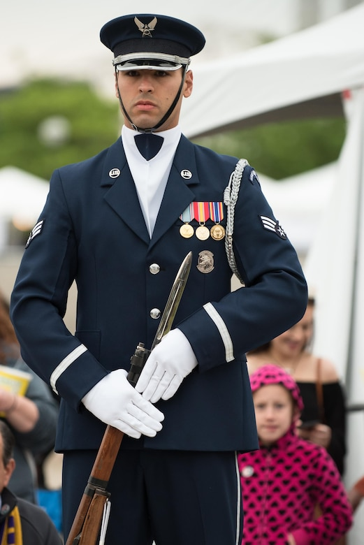 A member of the U.S. Air Force Honor Guard prepares to execute a precision rifle drill before an appreciative crowd at Waterfront Park in downtown Louisville, Ky., May 3, 2017, during the Kentucky Derby Festival. The Airman, from Joint Base Anacostia-Bolling in Washington, D.C., is part of a team that strives to represent the Air Force Core Values of integrity, service and excellence through precise drill movements, immaculate appearance and extreme attention to detail. (U.S. Air National Guard photo by Lt. Col. Dale Greer)
