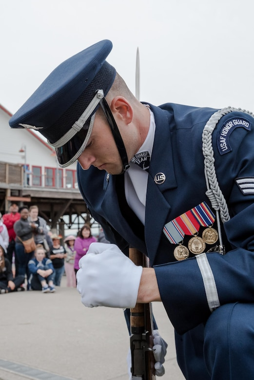 A member of the U.S. Air Force Honor Guard executes a precision rifle drill before an appreciative crowd at Waterfront Park in downtown Louisville, Ky., May 3, 2017, during the Kentucky Derby Festival. The Airman, from Joint Base Anacostia-Bolling in Washington, D.C., is part of a team that strives to represent the Air Force Core Values of integrity, service and excellence through precise drill movements, immaculate appearance and extreme attention to detail. (U.S. Air National Guard photo by Lt. Col. Dale Greer)