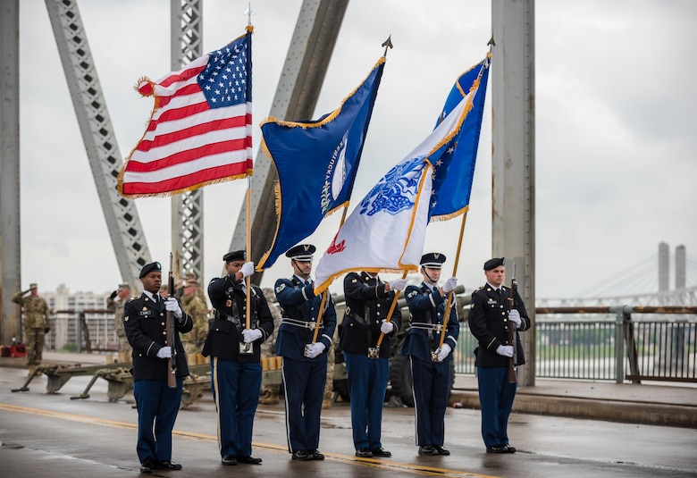 A joint color guard comprised of members from the Kentucky Army and Air National Guard present the colors to kick off the Thunder Over Louisville air show at the downtown waterfront in Louisville, Ky., April 22, 2017. The event, which features more than a dozen military aircraft, has grown to become the largest annual single-day air show in America. (U.S. Air National Guard photo by Lt. Col. Dale Greer)