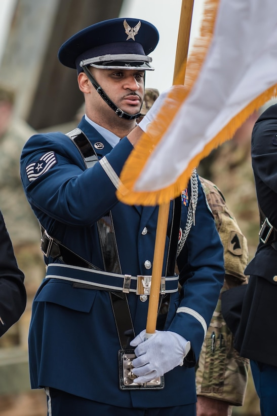 The Kentucky Air National Guard's Tech. Sgt. Jason Newby presents the colors to kick off the Thunder Over Louisville air show at the downtown waterfront in Louisville, Ky., April 22, 2017. The event, which features more than a dozen military aircraft, has grown to become the largest annual single-day air show in America. (U.S. Air National Guard photo by Lt. Col. Dale Greer)