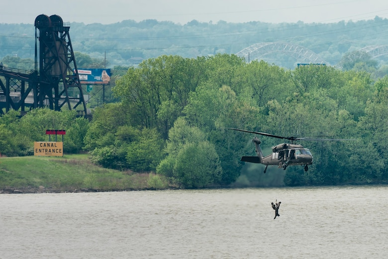 A Kentucky Army National Guard UH-60 Blackhawk hoists Airmen from the Kentucky Air Guard's 123rd Special Tactics Squadron into the aircraft after performing a simulated rescue mission in the Ohio River in Louisville, Ky., April 22, 2017. The demonstration was part of Thunder Over Louisville, an annual air show that draws hundreds of thousands of spectators to the banks of the Ohio. (U.S. Air National Guard photo by Lt. Col. Dale Greer)