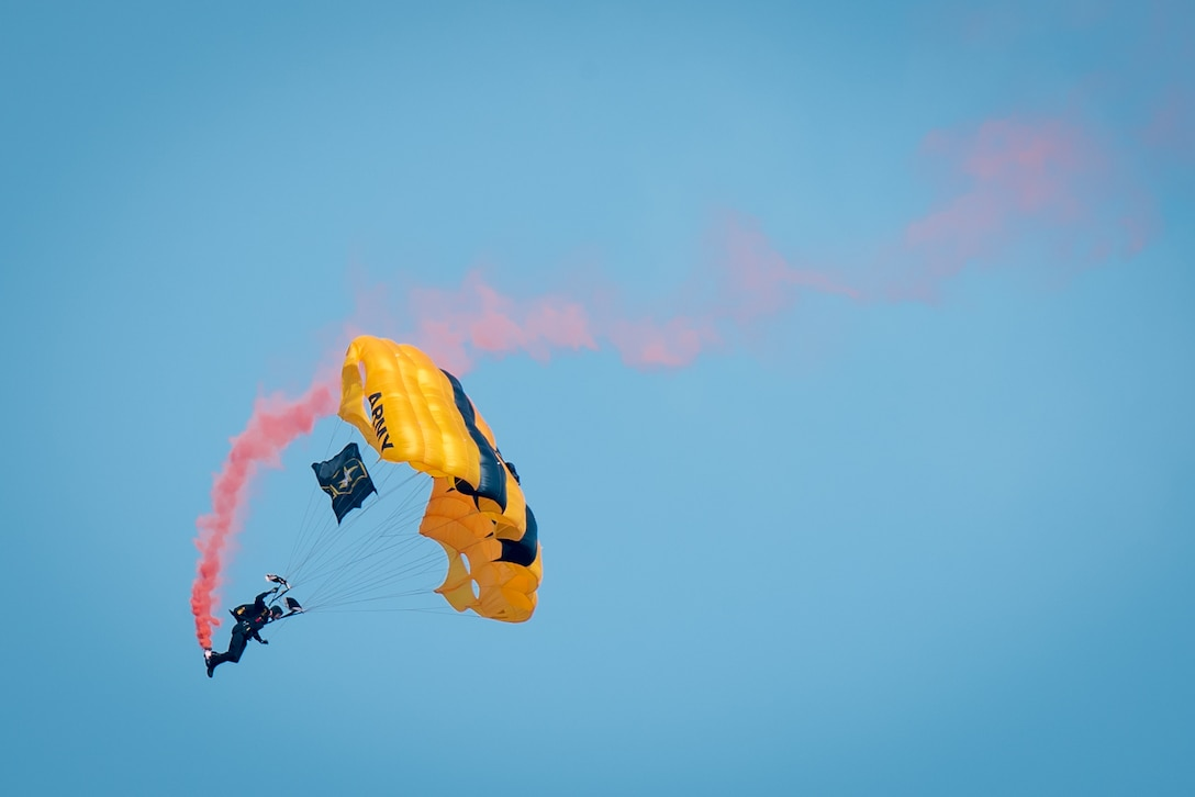 A soldier from the U.S. Army's Golden Knights demonstration team parachutes into downtown during the Thunder Over Louisville air show in Louisville, Ky., April 22, 2017. The annual event has grown to become the largest single-day air show in the nation. (U.S. Air National Guard photo by Lt. Col. Dale Greer)