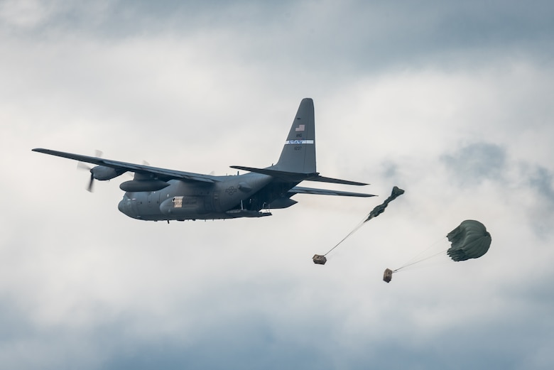 A C-130 Hercules aircraft from the Kentucky Air National Guard's 123rd Airlift Wing air-drops two bundles of cargo in the Ohio River during the Thunder Over Louisville air show in Louisville, Ky., April 22, 2017. The annual event has grown to become the largest single-day air show in the nation. (U.S. Air National Guard photo by Lt. Col. Dale Greer)