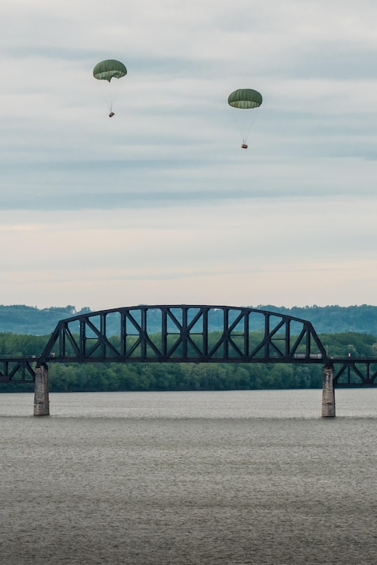 Two bundles of cargo float down to the Ohio River after being air-dropped from a Kentucky Air National Guard C-130 Hercules aircraft April 22, 2017, during the Thunder Over Louisville air show in Louisville, Ky. The annual event has grown to become the largest single-day air show in the nation. (U.S. Air National Guard photo by Lt. Col. Dale Greer)