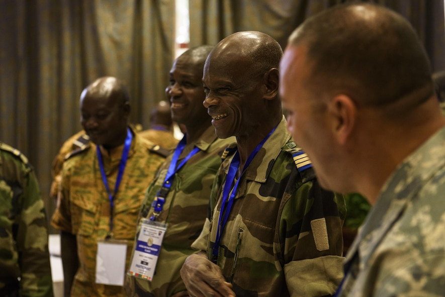 African Partnership Flight participants take a short break in between class discussions in Ouagadougou, Burkina Faso, April 18, 2017. APF in Burkina Faso hosted participants from Chad, Mali, Mauritania, Niger, Cote d'Ivoire and Morocco to help strengthen relationships and share best practices. (U.S. Air Force photo by Staff Sgt. Jonathan Snyder)