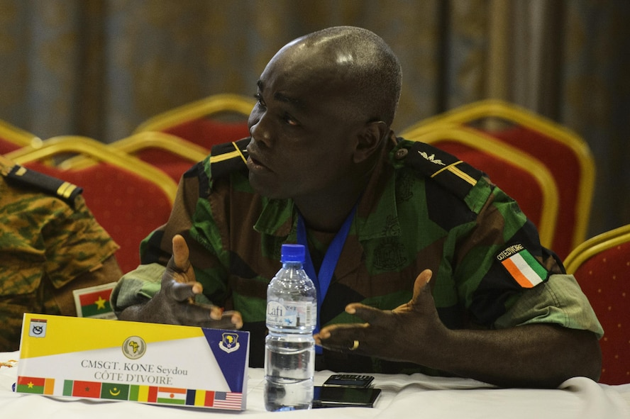 Chief Master Sgt. Kone Seydou,  Cote d'Ivoire air force, African Partnership Flight participant asks questions during the classroom discussion in Ouagadougou, Burkina Faso, April 18, 2017. APF in Burkina Faso hosted participants from Chad, Mali, Mauritania, Niger, Cote d'Ivoire and Morocco to help strengthen relationships and share best practices. (U.S. Air Force photo by Staff Sgt. Jonathan Snyder)