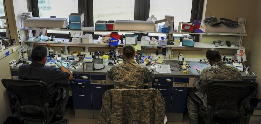Dental laboratory technicians with the 1st Special Operations Dental Squadron work in the dental lab at Hurlburt Field, Fla., May 2, 2017. The dental laboratory fabricates crowns, bridges, implants, night guards and sports guards. The six-man shop completes approximately 1,000 active cases a year. (U.S. Air Force photo by Airman 1st Class Isaac O. Guest IV)
