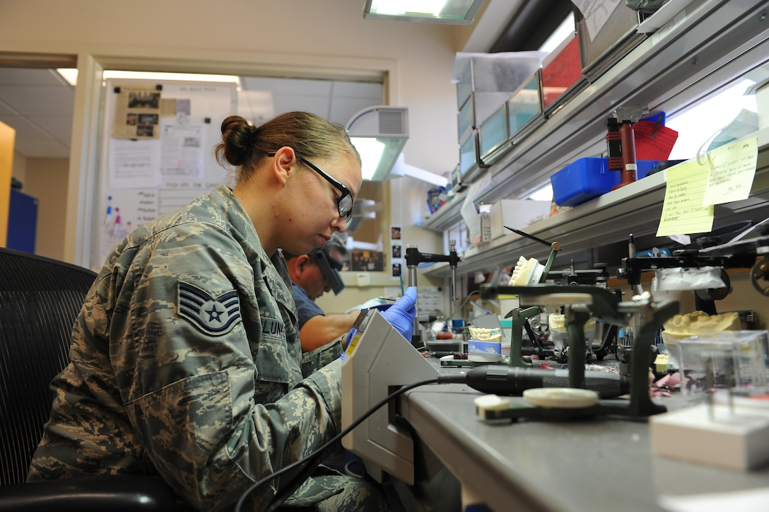 Staff Sgt. Kristina Plunkett, a dental laboratory technician with the 1st Special Operations Dental Squadron polishes a finished crown at Hurlburt Field, Fla., May 2 2017. The six-man shop completes approximately 1,000 active cases a year. (U.S. Air Force photo by Airman 1st Class Isaac O. Guest IV)