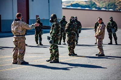 U.S. Marine Staff Sgt. Philip Barnes (left) instructs trainees in order to conduct the Reconnaissance, Surveillance and Decontamination Training aboard Marine Corps Base Camp Pendleton, Calif., April 26, 2017. Barnes goes over different safety precautions, prior to the trainees separating into their different training groups. The purpose of this training is to accomplish missions within a chemical, biological, radiological and nuclear environment.  Barnes is the current CBRN chief for 1st Maintenance Battalion, 1st Marine Logistics Group. (U.S. Marine Corps photo by Lance Corporal Salmineo Sherman Jr./Released)