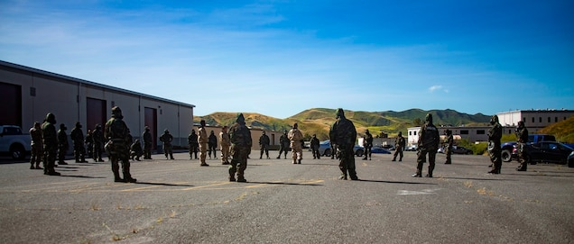 U.S. Marines from 1st Maintenance Battalion, 1st Marine Logistics Group, gather trainees to conduct Reconnaissance, Surveillance and Decontamination Training aboard Marine Corps Base Camp Pendleton, Calif., April 26, 2017. The trainees are receiving one final brief before separating into their training groups. The purpose of this training is to accomplish missions within a chemical, biological, radiological and nuclear environment. (U.S. Marine Corps photo by Lance Corporal Salmineo Sherman Jr./Released)