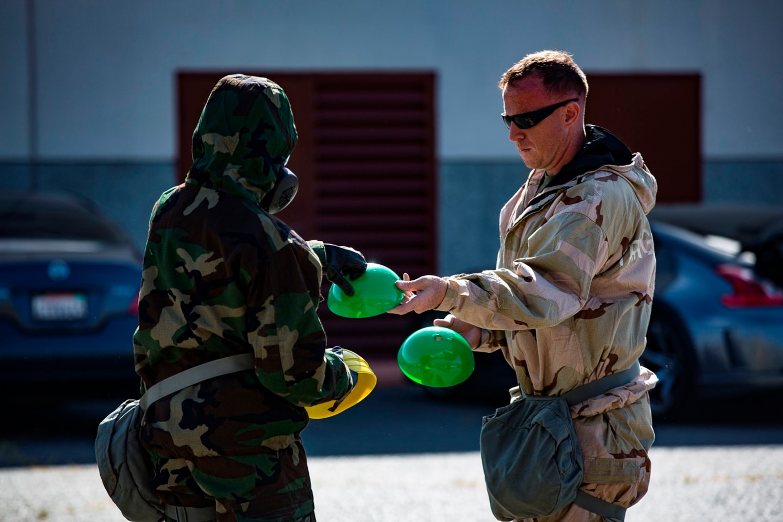 U.S. Marine Staff Sgt. Philip Barnes hands out cones to conduct Reconnaissance, Surveillance and Decontamination Training aboard Marine Corps Base Camp Pendleton, Calif., April 26, 2017. The cones serve as simulated threats and hazards in a chemical, biological, radiological and nuclear environment. The purpose of this training is to accomplish missions within CBRN environment.  Barnes is the current CBRN Chief for 1st Maintenance Battalion, 1st Marine Logistics Group. (U.S. Marine Corps photo by Lance Corporal Salmineo Sherman Jr./Released)