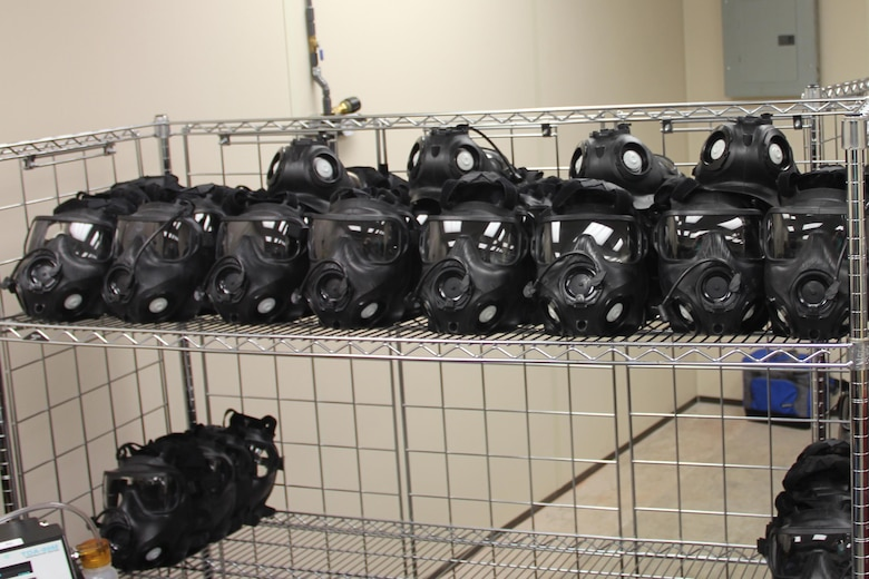 A rack of clean and sanitized M50 masks await visual inspection after coming out of the drying room. (U.S. Air Force photo/Rodney Whaley)