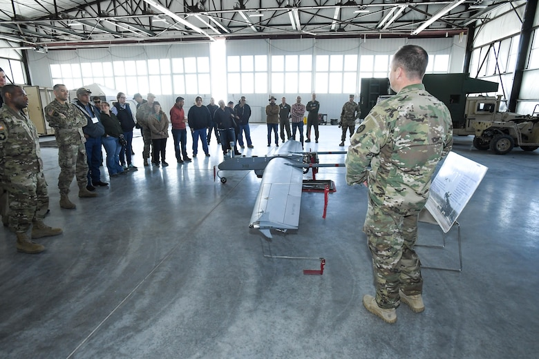 Representatives from American Indian tribes and DOD agencies are briefed on RQ-7B Shadow operations during a tour of the Utah National Guard's Unmanned Aerial System hangar, Wendover, Utah, April 28, 2017. Utah Department of Defense agencies hosted an annual face-to-face meeting April 27-28 with members of several American Indian Tribes who claim ancestral and ongoing ties to lands managed by the DOD agencies. Primary hosts for this year's meeting, which was held in the adjacent cities of West Wendover, Nev., and Wendover, Utah, were Dugway Proving Ground and the Confederated Tribes of the Goshute Reservation. Hill Air Force Base, the Utah National Guard and Tooele Army Depot co-hosted the event. (U.S. Air Force photo/R. Nial Bradshaw)