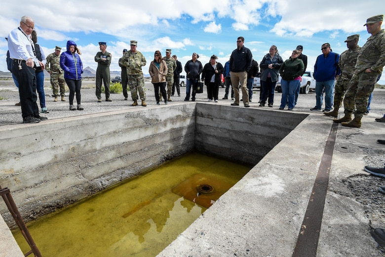 Historic Wendover Museum Foundation President Jim Petersen shows representatives from American Indian tribes and DOD agencies a bomb loading pit at Wendover Airfield, Wendover, Utah, April 28, 2017. Utah Department of Defense agencies hosted an annual face-to-face meeting April 27-28 with members of several American Indian Tribes who claim ancestral and ongoing ties to lands managed by the DOD agencies. Primary hosts for this year's meeting, which was held in the adjacent cities of West Wendover, Nev., and Wendover, Utah, were Dugway Proving Ground and the Confederated Tribes of the Goshute Reservation. Hill Air Force Base, the Utah National Guard and Tooele Army Depot co-hosted the event. (U.S. Air Force photo/R. Nial Bradshaw)