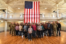 Representatives from American Indian tribes and DOD agencies pose for a photo at the Wendover Airfield Museum, Wendover, Utah, April 28, 2017. Utah DOD agencies hosted the annual face-to-face meeting with members of several American Indian Tribes who claim ancestral and ongoing ties to lands managed by the DOD agencies. (U.S. Air Force photo/R. Nial Bradshaw)