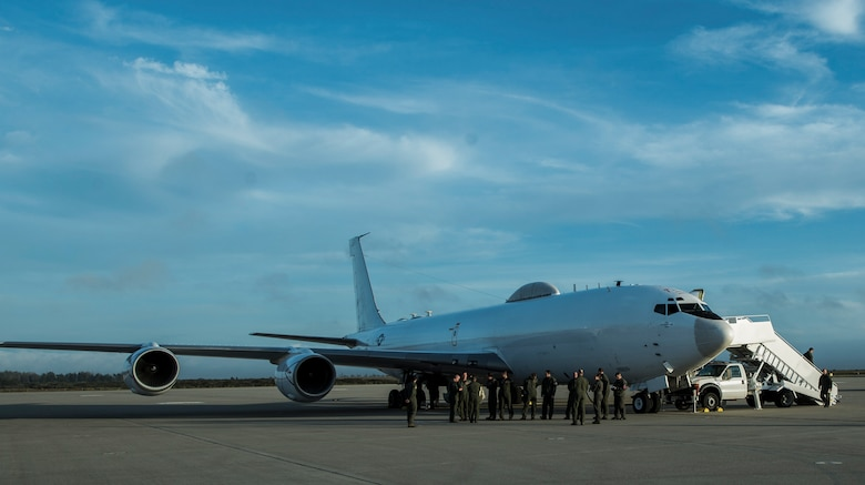 U.S. Air Force Airmen from various units within the 20th Air Force, gather outside of a U.S. Navy E-6B Mercury for a mission briefing before Glory Trip 220 at Vandenberg Air Force Base, Calif., April 25, 2017. Glory Trip is an exercise designed to bolster the readiness of U.S. Air Force missiliers to launch Intercontinental Ballistic Missiles (ICBM) at a moment's notice. (U.S. Air Force photo by Airman 1st Class Keifer Bowes)