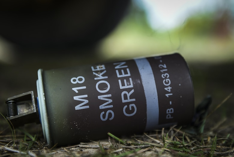 "An M18 smoke grenade is used to shelter the positions of 6th Special Operations Squadron combat aviation advisor students while they navigated through ""Palmetto Land"" during Operation Raven Claw at Duke Field, Fla., April 27, 2017. Throughout Raven Claw, students faced different scenarios to include providing casualty treatment for local civilians, handling potential human rights violations and reacting to improvised explosions during the middle of the night. (U.S. Air Force photo by Airman 1st Class Joseph Pick)"