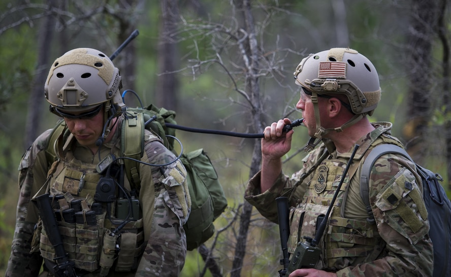 Lt. Col. Benjamin Griffith, right, a combat aviation advisor with the 6th Special Operations Squadron, drinks water from Capt. Cole Geldernick, a CAA with the 6th SOS, during Operation Raven Claw at Duke Field, Fla., April 27, 2017. Throughout Raven Claw, students faced different scenarios such as providing casualty treatment for local civilians, handling potential human rights violations and reacting to improvised explosions during the middle of the night. (U.S. Air Force photo by Airman 1st Class Joseph Pick)