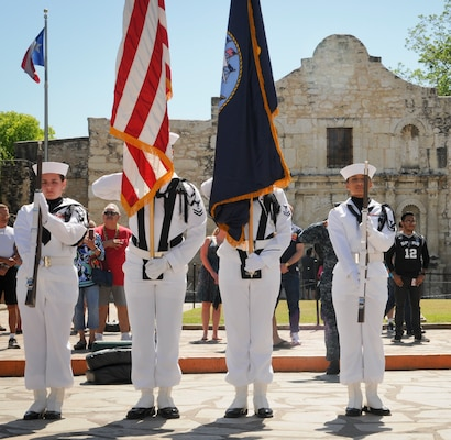 A Navy color guard unit parades the colors during Navy Day at the Alamo as part of Fiesta in downtown San Antonio. Ten different Navy commands in the San Antonio area gathered to celebrate with local military and community leaders. (This celebration was in April, but it fits with Navy Day.) (Photo by Petty Officer 1st Class Jacquelyn Childs)