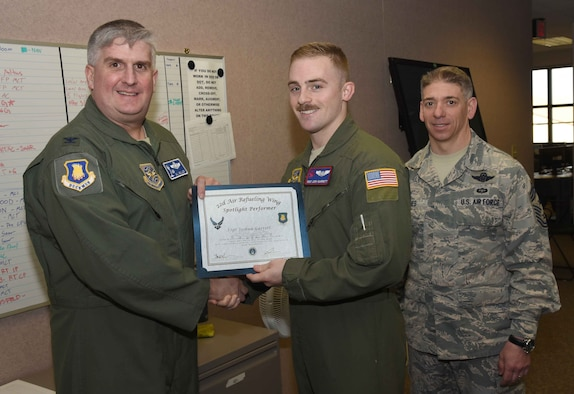 Staff Sgt. Josh Garrett, 350th Air Refueling Squadron instructor boom operator, poses with Col. Albert Miller, 22nd Air Refueling Wing commander, and Chief Master Sgt. Shawn Hughes, 22nd ARW command chief, April 6, 2017, at McConnell Air Force Base, Kan. Garrett received the spotlight performer for the week of March 27-31. (U.S. Air Force photo/Airman 1st Class Erin McClellan)