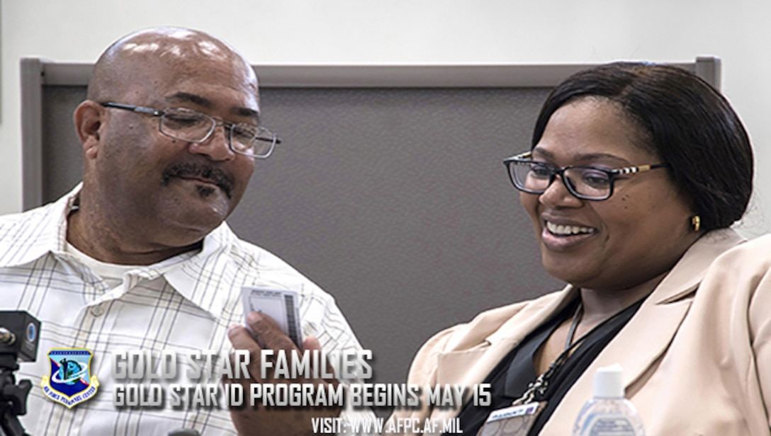 Michael L. Chavis, a Gold Star parent, shows his new Gold Star Base Access ID card to Carla Diamond, a U.S. Air Force Headquarters community readiness consultant, at Joint Base Andrews, Md., May 1, 2017. These cards are part of an Air Force initiative allowing Gold Star family members, immediate relatives of deceased Airmen, unescorted access to Air Force installations to visit buried loved ones, attend base events, and stop by Airmen and mily Readiness Centers for support. (U.S. Air Force photo/Senior Airman Jordyn Fetter)