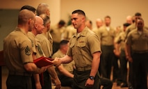 2nd Lt. Stephen Abernathy receives his Weapons and Tactics Instructor Course 2-17 certification during a ceremonial graduation at Marine Corps Air Station Yuma, Ariz., April 30, 2017. WTI is a seven week period of instruction that incorporates Marine Corps planning and implementation of advanced air and ground tactics through a series of escalating evolutions in order to produce certified Weapons and Tactics Instructors. More than 200 Marines and Sailors graduated from this class of WTI. Abernathy is a low altitude air defense officer assigned to 2nd Low Altitude Air Defense Battalion, Marine Air Control Group 28, 2nd Marine Aircraft Wing. (U.S. Marine Corps photo by Lance Cpl. Cody Lemons/Released)