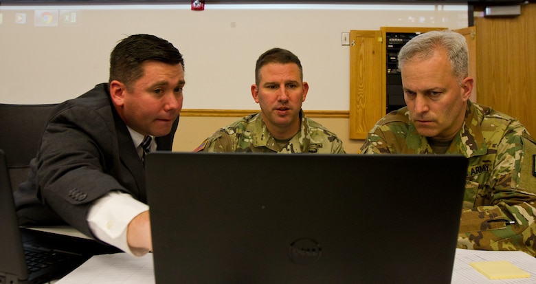 Dr. DJ Hovermale, the senior principal social engineer for the cyber exercise assessment studies and analysis division at Science Applications International Corporations (SAIC) out of Huntsville, Al., and Col. John Zierdt, the Army Reserve Cyber Shield Exercise leader of the 75th Training Command, Golf Training Division, out of Birmingham, Al., explain white cell operations to Col. Michael D. Smith, commander for the Army Reserve Cyber Operations Group out of Adelphi, Md., during Cyber Shield 17 at Camp Williams, Utah, May 2, 2017. Cyber Shield is a National Guard exercise, in cooperation with U.S. Army Reserve, that provides Soldiers, Air men and civilians from several sates and territories the opportunity to test their skills in response to cyber-incidents in a multi-service environment. (Army Reserve photo by Sgt. Stephanie Ramirez)