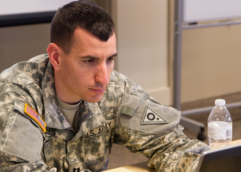 Capt. Nicholas Oles, an Exercise Cyber Shield 17 team leader from the Ohio Army National Guard out of Columbus, Ohio, surveys statistical progress of training on his computer as part of the Cyber Shield 17 multi-service training exercise conducted at Camp Williams, Utah, on May 2, 2017. Exercise Cyber Shield 17 is the sixth iteration of this training exercise and this year unites the Army National Guard with members of the Air National Guard, Army Reserve, and civilians from private companies, state government agencies, federal agencies, industry partners, and academia. (U.S. Army Reserve photo by Spc. Christopher Hernandez)