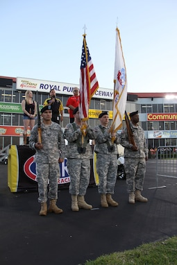 In this image released by the Army Reserve's 75th Training Command, soldiers with the unit's Headquarters Company present U.S. and Army flags at a drag racing event in Baytown, Texas, Friday, April 21, 2017. The event, the National Hod Rod Association's Spring Nationals, featured the participation of several Army organizations as part of the service's ongoing recruiting and community relations effort. The 75th Training Command, the senior military headquarters for Houston and the surrounding region, regularly plays a role in events of a public nature. (Photo/75th Training Command, Army Reserve Sgt. 1st Class Danial Lisarelli)