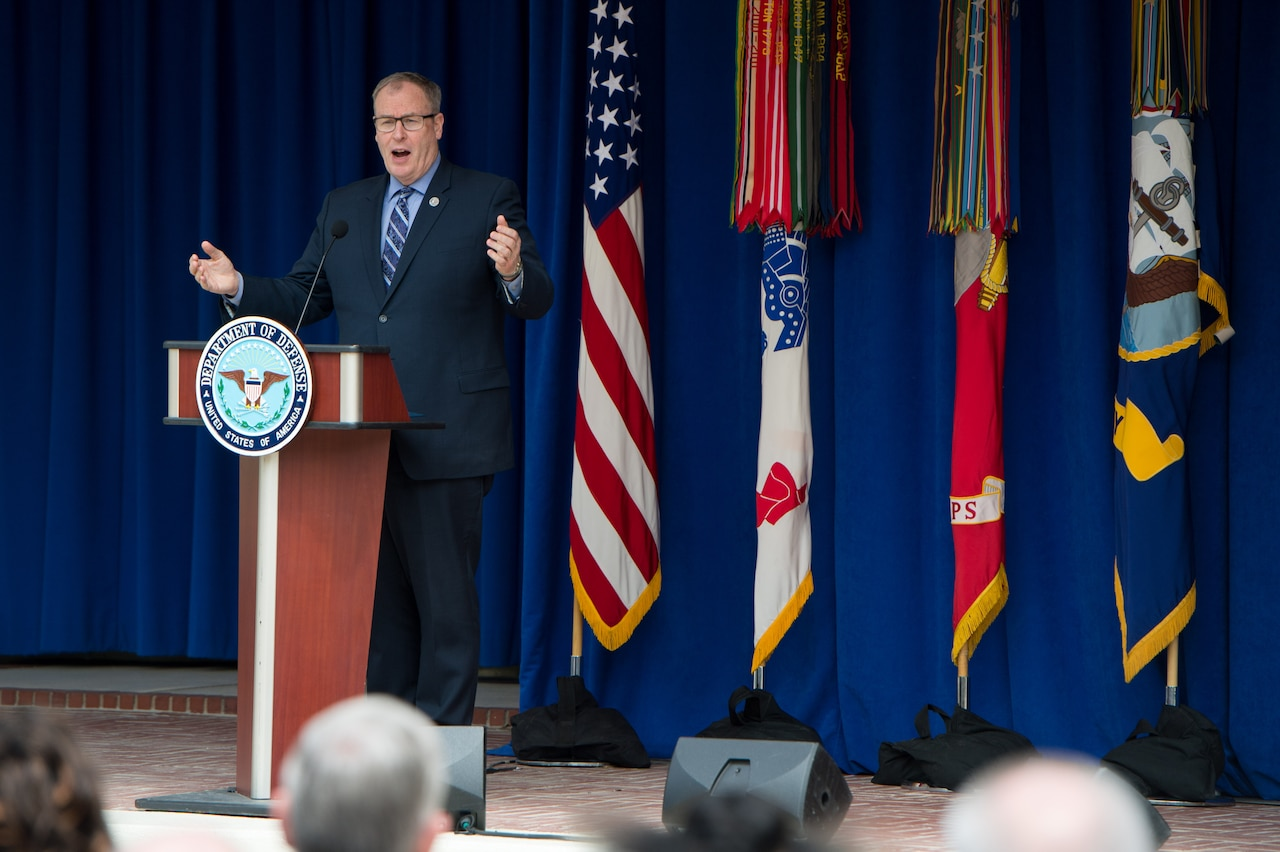 Deputy Defense Secretary Bob Work addresses an audience in the Pentagon's center courtyard at DoD's annual Spirit of Service awards ceremony as part of Public Service Recognition Week, May 4, 2017. During the ceremony, the deputy greeted each of the two dozen award recipients, who represented DoD and the service branches in the National Capital Area, and gave each a challenge coin. DoD photo by Air Force Staff Sgt. Jette Carr