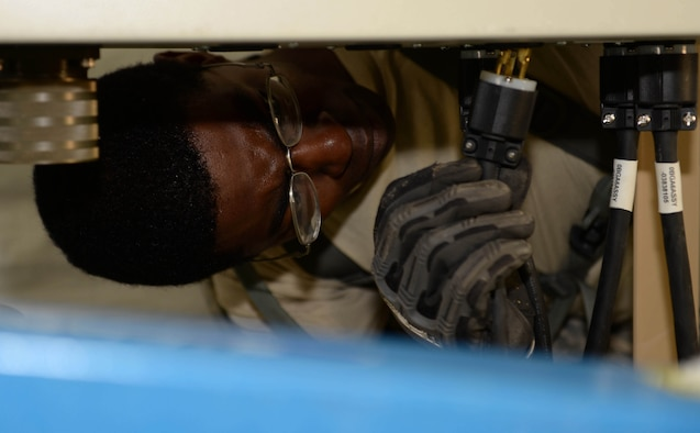 U.S. Air Force Staff Sgt. Stark Sarrazin, a water and fuel systems maintenance craftsman with the 635th Materiel Maintenance Squadron out of Holloman Air Force Base, N.M., plugs up a dryer in a newly-constructed laundry facility in the Dominican Republic, March 29, 2017, as part of NEW HORIZONS 2017. The facility was equipped with 20 dryer units to support approximately 450 Airmen, Soldiers, Marines and Sailors in the Dominican Republic participating in the annual exercise to train military civil engineers and medical professionals to deploy and conduct joint operations. (U.S. Air Force photo by Staff Sgt. Timothy M. Young)