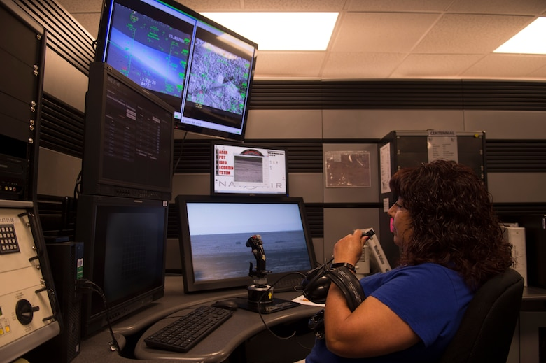 Sarah Hernandez, a 49th Operations Support Squadron range operations center operator, checks the laser board systems on April 21, 2017 at Holloman Air Force Base, N.M. The ROC operators assist student pilots with dropping bombs on target and scoring how close the ordnance impacted the intended target. (U.S. Air Force photo by Tech. Sgt. Amanda Junk)