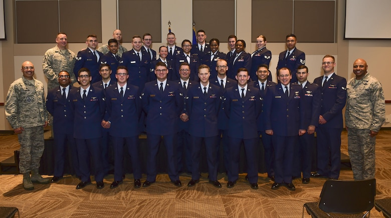 The first Mission Qualification Training graduation class Airmen stand together for a photo May 4, 2017, on Buckley Air Force Base, Colo. MQT is the secondary part of training that all of Buckley AFB's space operators receive to become certified and familiarized with the base's specific weapon system. (U.S. Air Force photo by Airman Jacob Deatherage/Released)