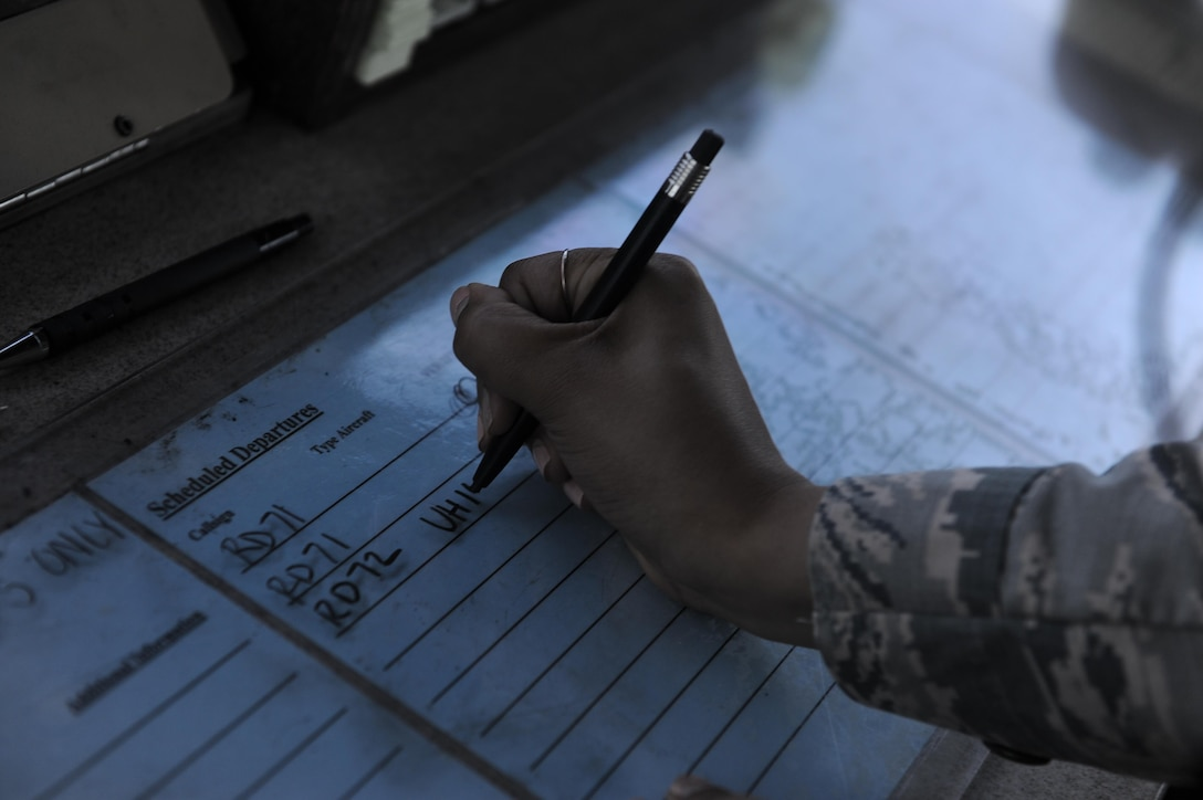 Airman 1st Class Victoria Swain, an air traffic control journeyman with the 1st Special Operations Support Squadron, writes down scheduled departures of aircraft at Hurlburt Field, Fla., May 3, 2017. Air traffic controllers track and supervise aircraft movement on the flight line and in the air. (U.S. Air Force photo by Airman 1st Class Isaac O. Guest IV)