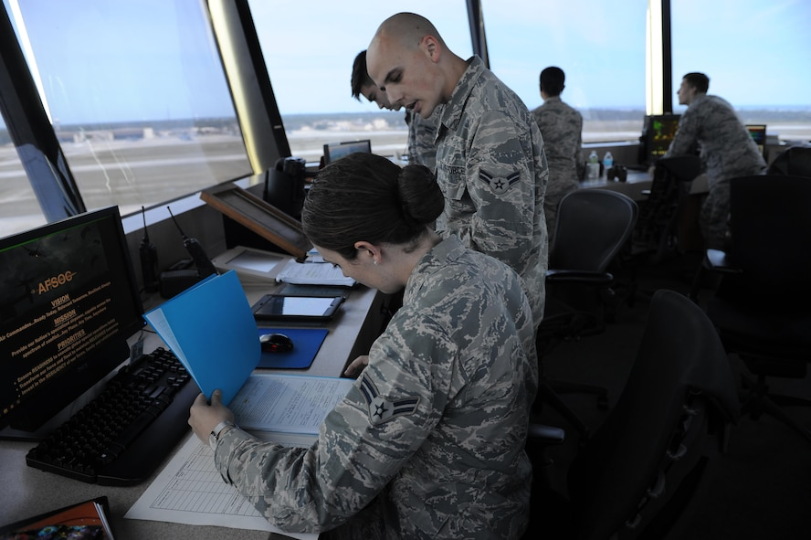 Airmen 1st Class Tristen Saucier and Chris Kondysar, air traffic control apprentices with the 1st Special Operations Support Squadron, update training records at Hurlburt Field, Fla., May 3, 2017. Air traffic controllers provide safe and organized flow of aircraft on the flight line and in the air by monitoring and keeping track of scheduled incoming and departing aircraft. (U.S. Air Force photo by Airman 1st Class Isaac O. Guest IV)