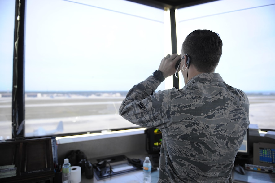 Airman 1st Class Tyler Haley, an air traffic control apprentice with the 1st Special Operations Support Squadron, monitors and communicates with an incoming pilot through a headset at Hulburt Field, Fla., May 3, 2017.  Air traffic controllers provide safe and organized flow of aircraft on the flight line and in the air. (U.S. Air Force photo by Airman 1st Class Isaac O. Guest IV)
