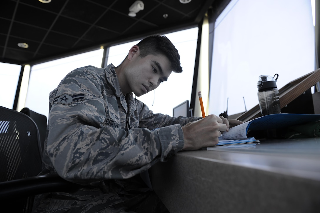 Airman 1st Class Kevin Crilley, an air traffic control apprentice with the 1st Special Operations Support Squadron, reviews his training record at Hurlburt Field, Fla., May 3, 2017. Air traffic controllers provide safe and organized flow of aircraft on the flight line and in the air by monitoring and keeping track of scheduled incoming and departing aircraft. (U.S. Air Force photo by Airman 1st Class Isaac O. Guest IV)