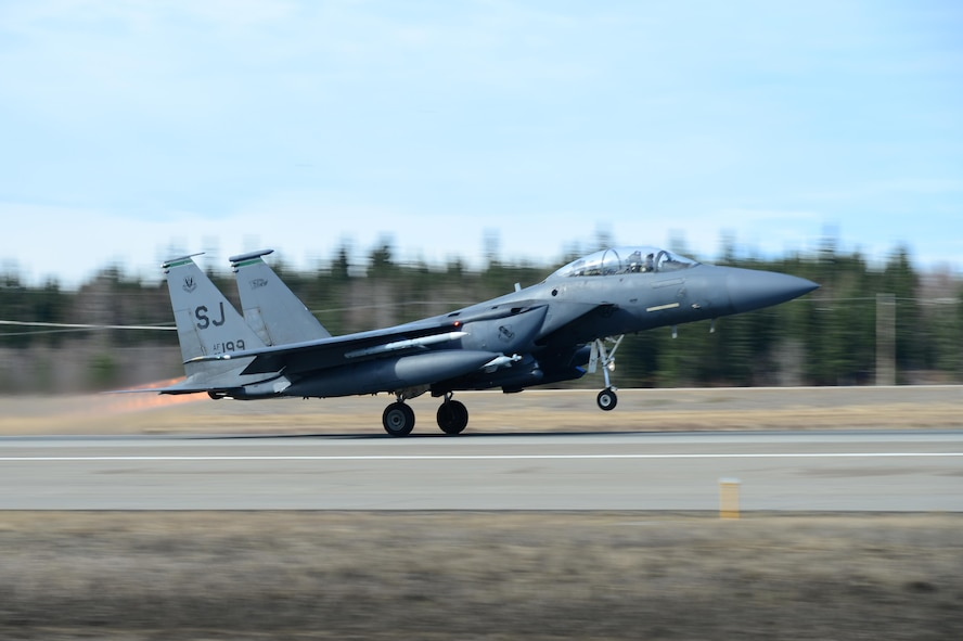 EIELSON AIR FORCE BASE, Alaska – A U.S. Air Force F-15E Strike Eagle dual-role fighter aircraft assigned to the 335th Fighter Squadron, Seymour Johnson Air Force Base, N.C., takes off for a sortie from Eielson Air Force Base, Alaska, May 4, 2017 during NORTHERN EDGE 2017 (NE17). NE17 is Alaska's premier joint training exercise designed to practice operations, techniques and procedures as well as enhance interoperability among the services. Thousands of participants from all the services, Airmen, Soldiers, Sailors, Marines and Coast Guardsmen from active duty, Reserve and National Guard units are involved. (U.S. Air Force photo by Airman Eric M. Fisher)