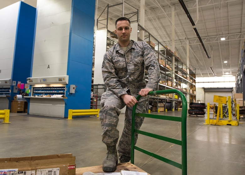 Staff Sgt. Brandon Paige, 92nd Logistic Readiness Squadron NCO in charge of the Flight Service Center, pauses while moving parts for shipping Mar. 22, 2017, at Fairchild Air force Base, Washington. The Flight Service Center handles all of the bases parts shipping and tracking logistic needs.