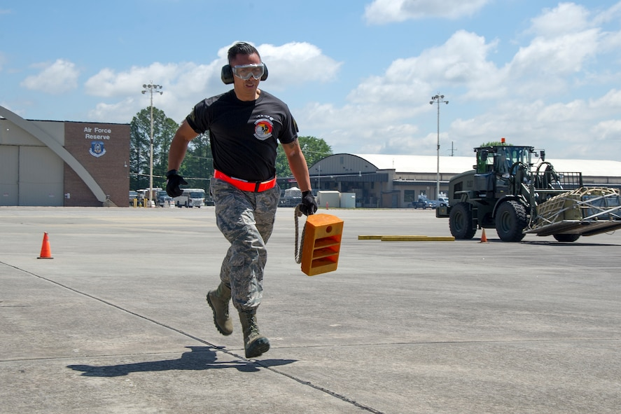 "Reserve Citizen Airman Tech. Sgt. Eric Ignacio, of Honolulu, Hawaii, a member of the 48th Aerial Port Squadron based out of Joint Base Pearl Harbor-Hickam, Hawaii, hustles to place down a vehicle chalk block as a part of the 4th biennial Air Force Reserve Command's Port Dawg Challenge, at Dobbins Air Reserve Base, Ga., April 25, 2017. The 48th APS was one of 23 teams competing in the Port Dawg Challenge, which was designed to test and maintain the camaraderie of aerial port Airmen while promoting professionalism, leadership, training and communication between ""Port Dawgs."" The 48th APS is a component of the Air Force Reserve, providing expertise in all areas of air terminal operations to include aircraft loading, cargo processing and inspecting, passenger services, aircraft fleet services and aerial port command and control. (U.S. Air Force photo by Master Sgt. Theanne K. Herrmann)"