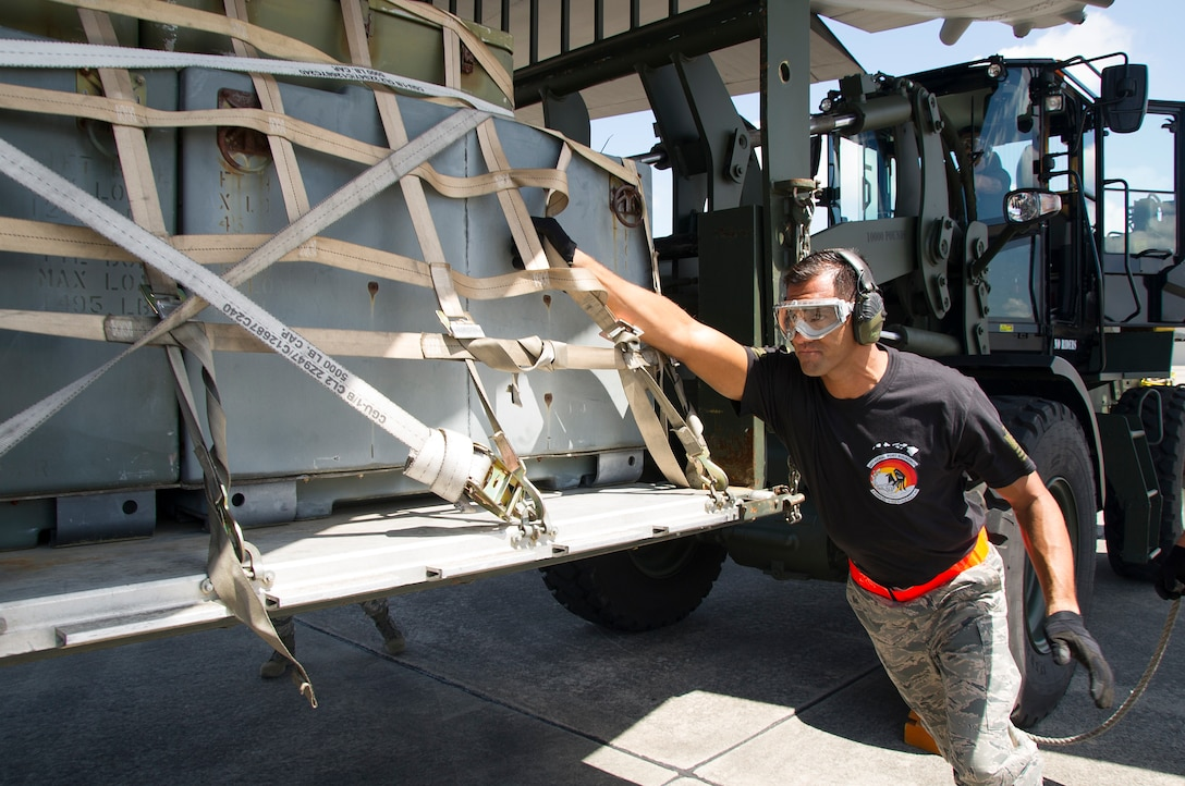 """Reserve Citizen Airman Master Sgt. Alfred Van Gieson, of Nanakuli, Hawaii and a member of the 48th Aerial Port Squadron, guides a pallet of equipment onto the C-130 Hercules aircraft during the Port Dawg Challenge at Dobbins Air Reserve Base, Ga., April 25, 2017. The 48th APS, based out of Joint Base Pearl Harbor-Hickam, Hawaii, was one of 23 teams competing in the 4th biennial Air Force Reserve Command's Port Dawg Challenge, which was designed to test and maintain the camaraderie of aerial port Airmen while promoting professionalism, leadership, training and communication between """"Port Dawgs."""" The 48th APS is a component of the Air Force Reserve, providing expertise in all areas of air terminal operations to include aircraft loading, cargo processing and inspecting, passenger services, aircraft fleet services and aerial port command and control. (U.S. Air Force photo by Master Sgt. Theanne K. Herrmann)"""