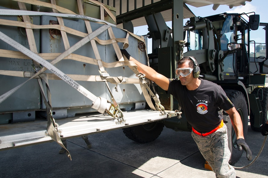 "Reserve Citizen Airman Master Sgt. Alfred Van Gieson, of Nanakuli, Hawaii and a member of the 48th Aerial Port Squadron, guides a pallet of equipment onto the C-130 Hercules aircraft during the Port Dawg Challenge at Dobbins Air Reserve Base, Ga., April 25, 2017. The 48th APS, based out of Joint Base Pearl Harbor-Hickam, Hawaii, was one of 23 teams competing in the 4th biennial Air Force Reserve Command's Port Dawg Challenge, which was designed to test and maintain the camaraderie of aerial port Airmen while promoting professionalism, leadership, training and communication between ""Port Dawgs."" The 48th APS is a component of the Air Force Reserve, providing expertise in all areas of air terminal operations to include aircraft loading, cargo processing and inspecting, passenger services, aircraft fleet services and aerial port command and control. (U.S. Air Force photo by Master Sgt. Theanne K. Herrmann)"