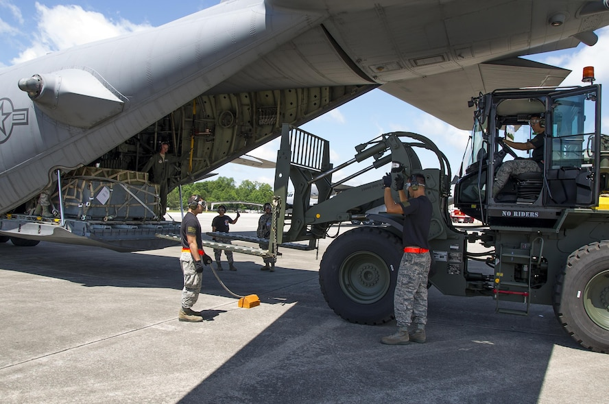 "Reserve Citizen Airmen members from the 48th Aerial Port Squadron, based out of Joint Base Pearl Harbor-Hickam, Hawaii, uses a 10K forklift to load a pallet onto a C-130 Hercules aircraft during the Port Dawg Challenge at Dobbins Air Reserve Base, Ga., April 25, 2017. The 48th Aerial Port Squadron was one of 23 teams competing in the 4th biennial Air Force Reserve Command's Port Dawg Challenge, which was designed to test and maintain the camaraderie of aerial port Airmen while promoting professionalism, leadership, training and communication between ""Port Dawgs."" The 48th APS is a component of the Air Force Reserve, providing expertise in all areas of air terminal operations to include aircraft loading, cargo processing and inspecting, passenger services, aircraft fleet services and aerial port command and control. (U.S. Air Force photo by Master Sgt. Theanne K. Herrmann)"