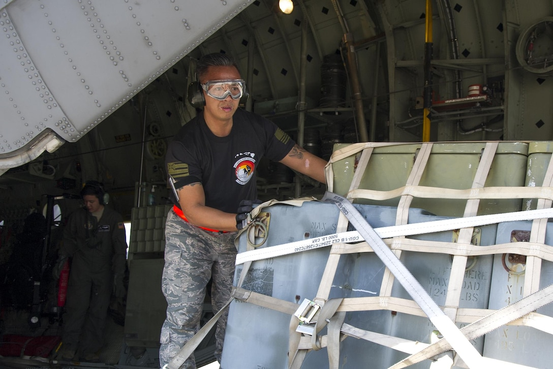 "Reserve Citizen Airman Tech. Sgt. Eric Ignacio, of Honolulu, Hawaii, an aerial transportation specialist with the 48th Aerial Port Squadron, guides a pallet of equipment onto the C-130 H during the Port Dawg Challenge at Dobbins Air Reserve Base, Ga., April 25, 2017.  The 48th APS, based out of Joint Base Pearl Harbor-Hickam, Hawaii, was one of 23 teams competing in the 4th biennial Air Force Reserve Command's Port Dawg Challenge, which was designed to test and maintain the camaraderie of aerial port Airmen while promoting professionalism, leadership, training and communication between ""Port Dawgs."" The 48th APS is a component of the Air Force Reserve, providing expertise in all areas of air terminal operations to include aircraft loading, cargo processing and inspecting, passenger services, aircraft fleet services and aerial port command and control. (U.S. Air Force photo by Master Sgt. Theanne K. Herrmann)"