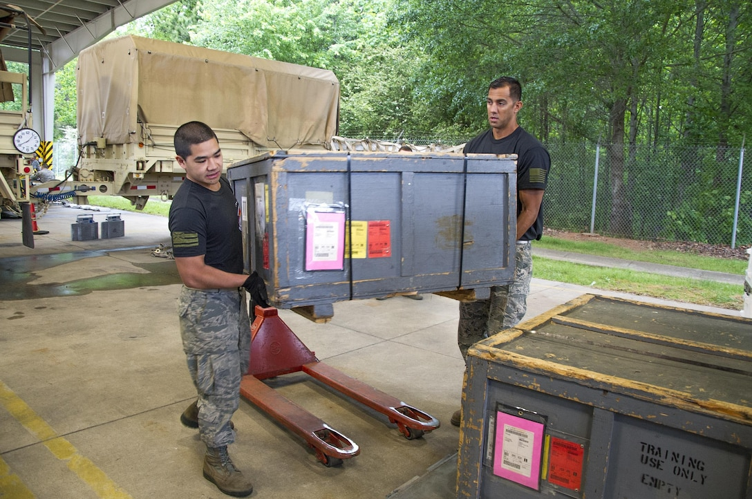 "Reserve Citizen Airmen Tech. Sgt. Marlon Gibo, left, and Master Sgt. Alfred Van Gieson, both with the 48th Aerial Port Squadron, load equipment onto a pallet during the Port Dawg Challenge at Dobbins Air Reserve Base, Ga., April 25, 2017.  The 48 APS was one of 23 teams competing in the 4th biennial Air Force Reserve Command's Port Dawg Challenge, which was designed to test and maintain the camaraderie of aerial port Airmen while promoting professionalism, leadership, training and communication between ""Port Dawgs."" The 48th APS, located on Joint Base Pearl Harbor-Hickam, Hawaii, is a component of the Air Force Reserve, providing expertise in all areas of air terminal operations to include aircraft loading, cargo processing and inspecting, passenger services, aircraft fleet services and aerial port command and control. (U.S. Air Force photo by Master Sgt. Theanne K. Herrmann)"