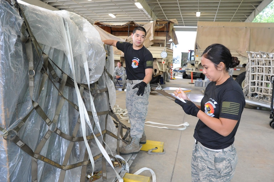 "Reserve Citizen Airmen Tech. Sgt. Marlon Gibo, of Honolulu, Hawaii, and Staff Sgt. Amber Picon, of Waipahu, Hawaii, both with the 48th Aerial Port Squadron, inventory equipment being loaded onto a pallet during the Port Dawg Challenge at Dobbins Air Reserve Base, Ga., April 25, 2017. The 48th APS was one of 23 teams competing in the 4th biennial Air Force Reserve Command's Port Dawg Challenge, which was designed to test and maintain the camaraderie of aerial port Airmen while promoting professionalism, leadership, training and communication between ""Port Dawgs."" The 48th APS, located on Joint Base Pearl Harbor-Hickam, Hawaii, is a component of the Air Force Reserve, providing expertise in all areas of air terminal operations to include aircraft loading, cargo processing and inspecting, passenger services, aircraft fleet services and aerial port command and control. (U.S. Air Force photo by Master Sgt. Theanne K. Herrmann)"