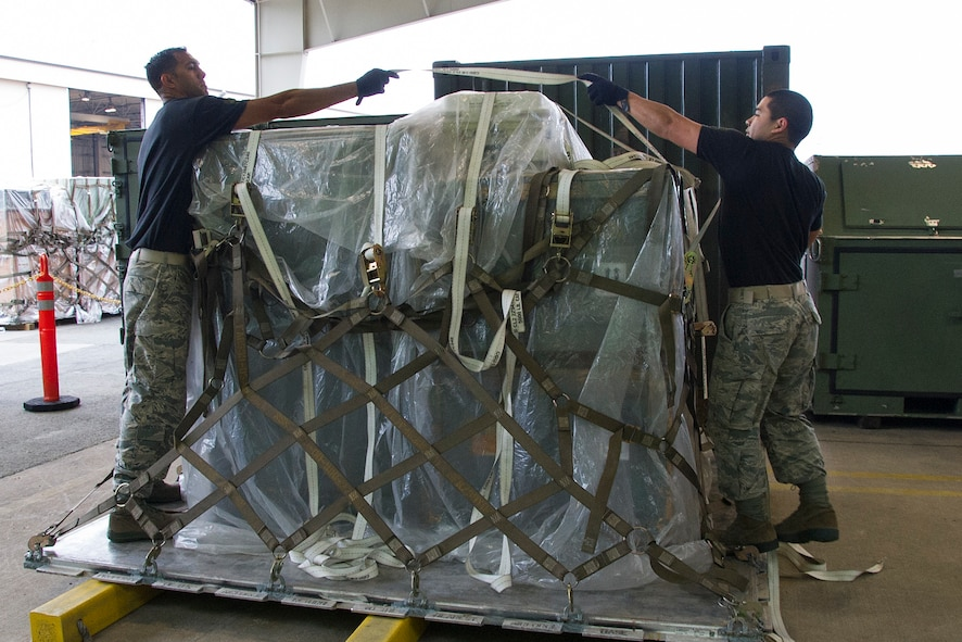 "Reserve Citizen Airmen Master Sgt. Alfred Van Gieson, left, of Nanakuli, Hawaii, and Tech. Sgt. Marlon Gibo, of Honolulu, Hawaii, secure equipment onto a pallet during the Port Dawg Challenge at Dobbins Air Reserve Base, Ga., April 25, 2017.  Van Gieson and Gibo, transportation specialists with the 48th Aerial Port Squadron, competed in the 4th biennial Air Force Reserve Command's Port Dawg Challenge, which was designed to test and maintain the camaraderie of aerial port Airmen while promoting professionalism, leadership, training and communication between ""Port Dawgs."" The 48th APS, located on Joint Base Pearl Harbor-Hickam, Hawaii, is a component of the Air Force Reserve, providing expertise in all areas of air terminal operations to include aircraft loading, cargo processing and inspecting, passenger services, aircraft fleet services and aerial port command and control. (U.S. Air Force photo by Master Sgt. Theanne K. Herrmann)"