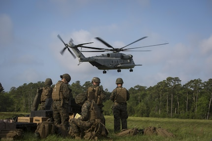 CAMP LEJEUNE, N.C. – Marines and sailors with the Command Element, Special Purpose Marine Air-Ground Task Force - Southern Command, standby to load gear while a CH-53E Super Stallion helicopter lands during General Exercise 2 at Marine Corps Base Camp Lejeune, North Carolina, April 29, 2017. The Marines simulated a noncombatant evacuation operation in order to prepare for crisis response situations they could face during their deployment to Central America. (U.S. Marine Corps photo by Sgt. Ian Leones)