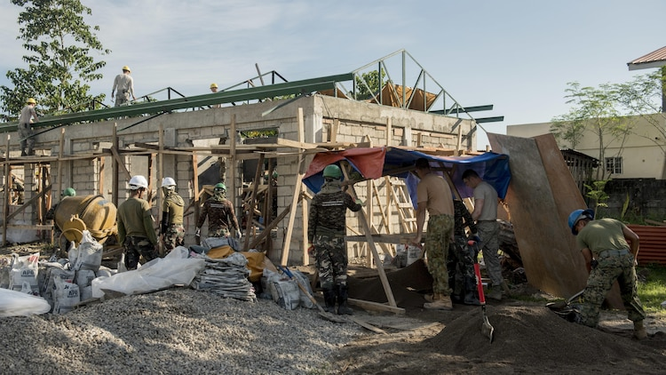 U.S. military, Australian Soldiers, and the Armed Forces of the Philippines prepare a structure for concrete work during Balikatan 2017 in Ormoc City, Leyte, April 29, 2017. Engineers from the three nations worked together to build new classrooms at Margen Elementary School in Ormoc City. Balikatan is an annual U.S.-Philippine military bilateral exercise focused on a variety of missions, including humanitarian assistance and disaster relief, counterterrorism, and other combined military operations.