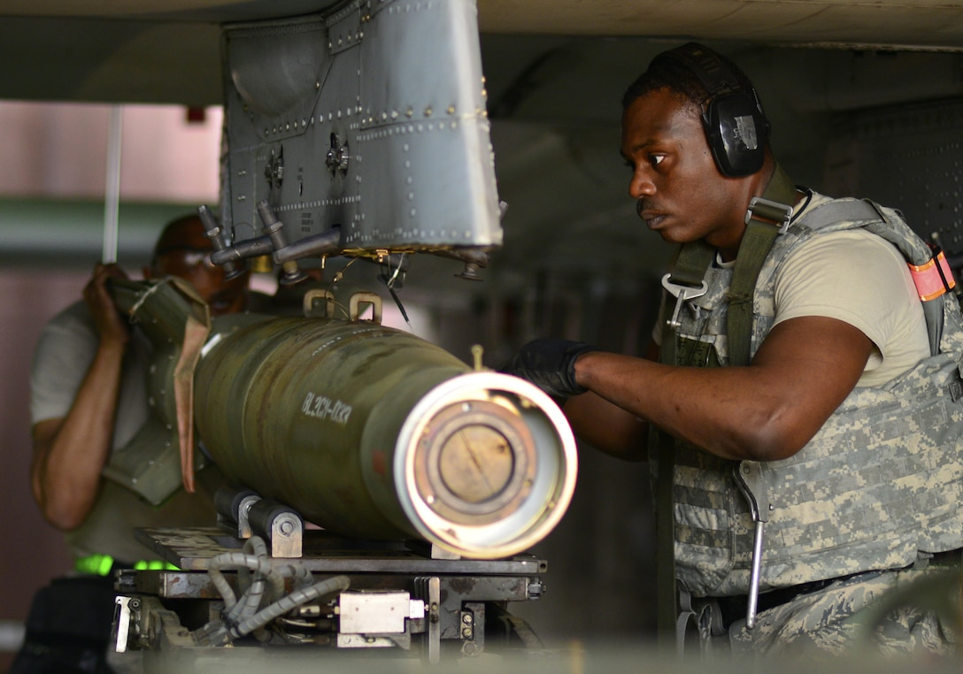 U.S. Air Force Staff Sgt. Terry White, 51st Maintenance Group weapons crew team member, secures munitions on an A-10 Thunderbolt II during Exercise Beverly Herd 17-2 at Osan Air Base, Republic of Korea, May 4, 2017. The no-notice exercise challenged the tradition of planning exercises weeks or months in advance, allowing wing leadership a view of how personnel would respond in real-world situations. (U.S. Air Force photo by Staff Sgt. Alex Fox Echols III)
